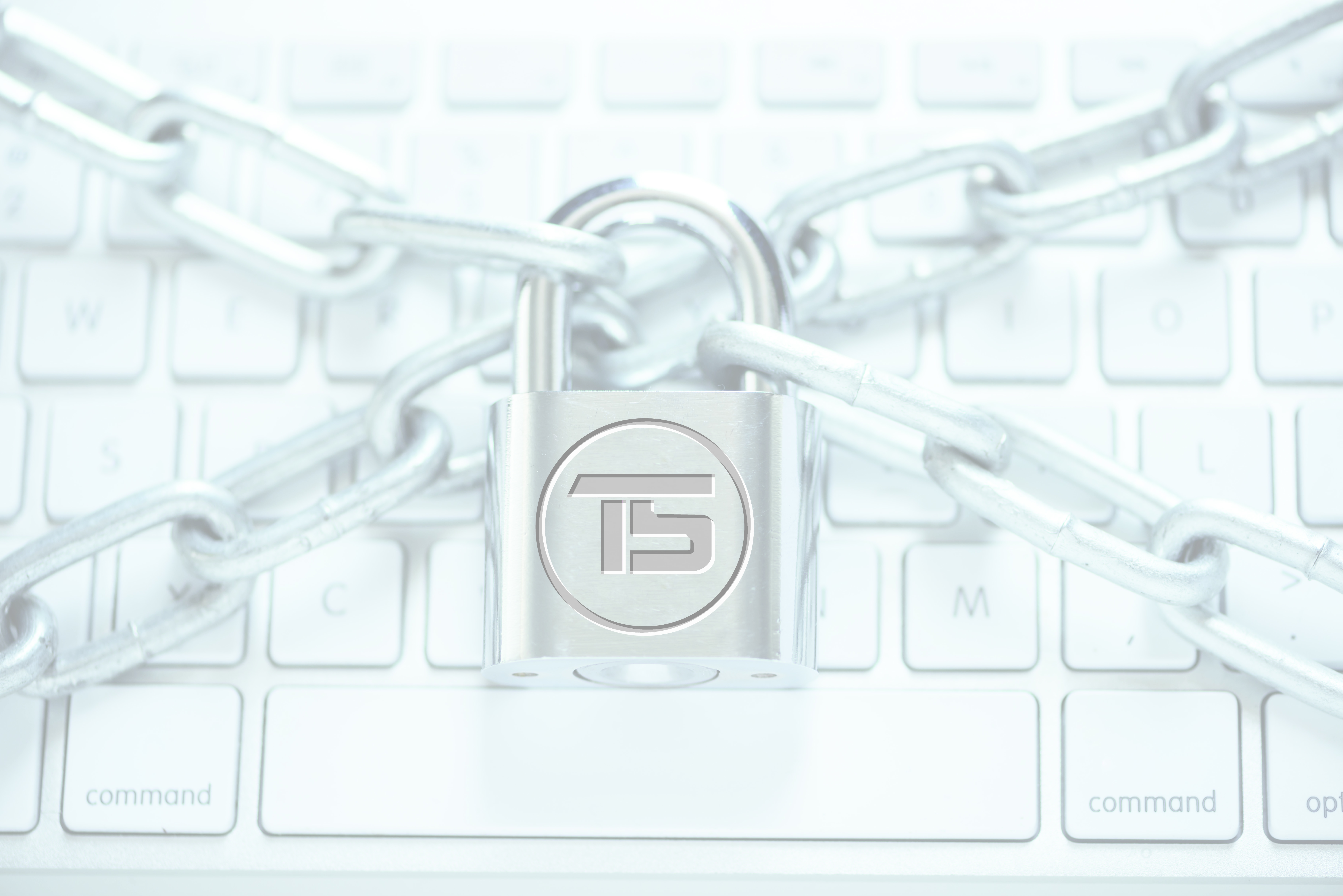 Close-up of laptop with chains and lock