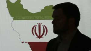 silhouette of man in front of Iran's flag